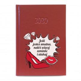 Czerwony kalendarz z nadrukiem